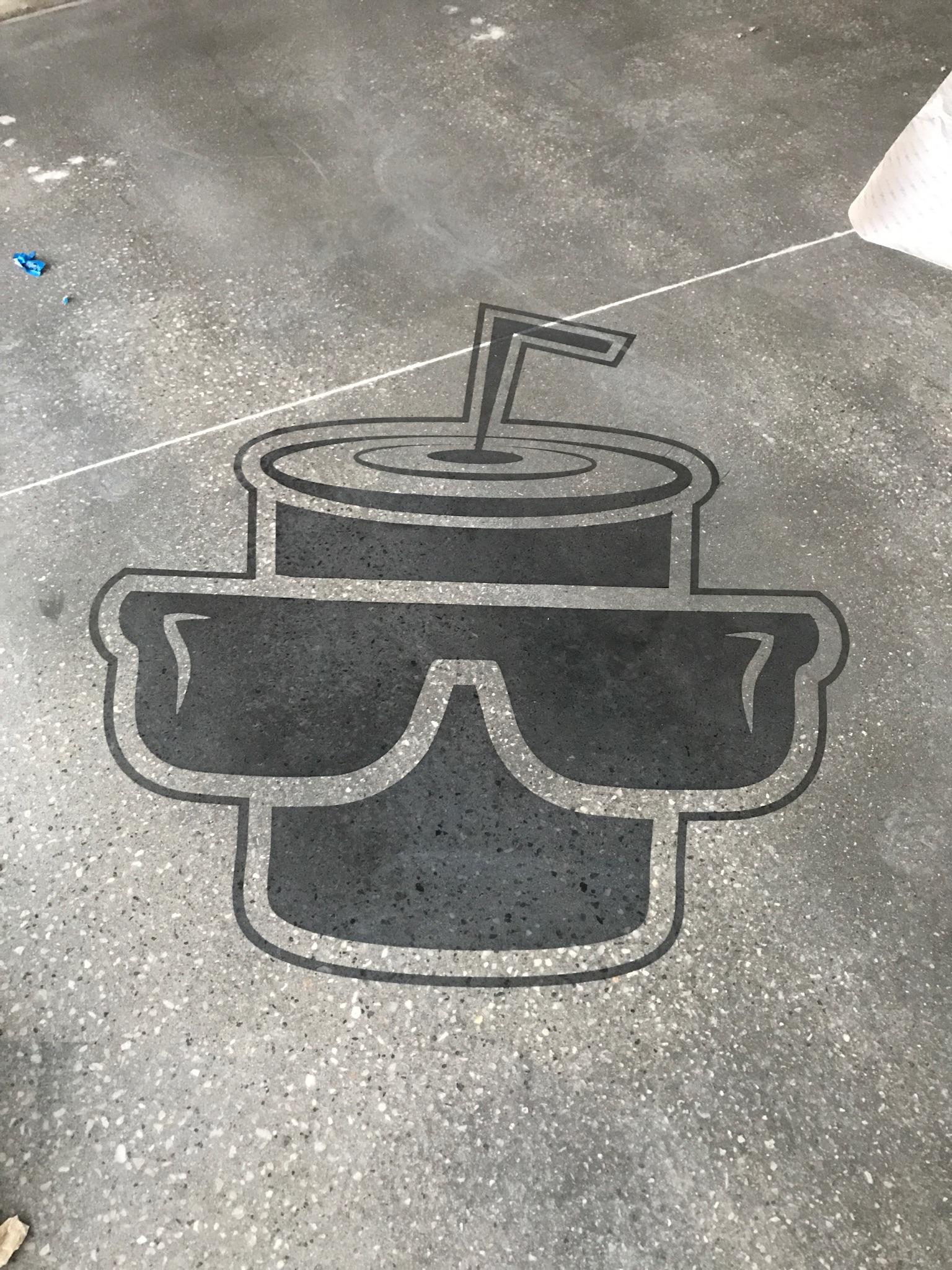 Logo on concrete floor