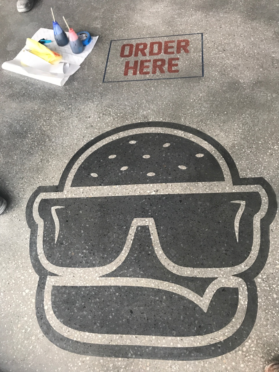 Order Here design on Concrete Floor with Logo