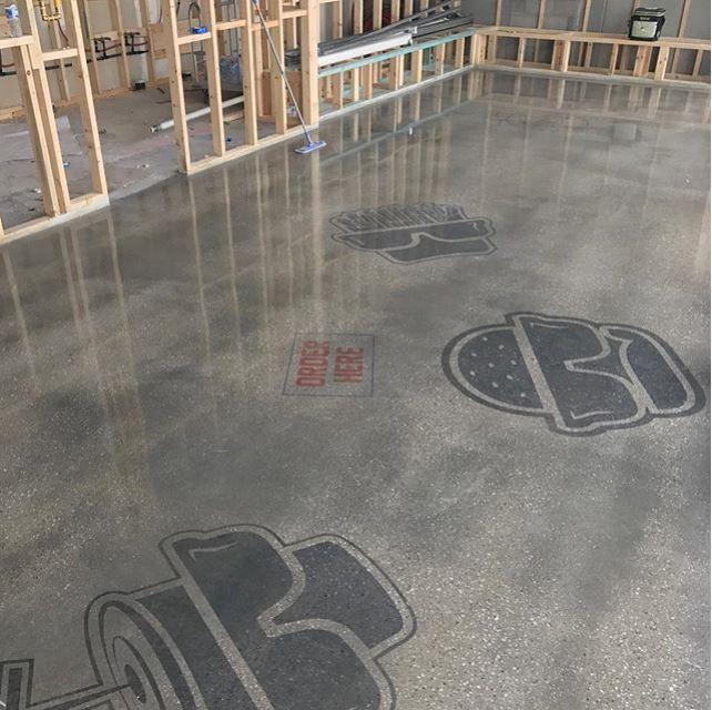 Logos Designed on Concrete Floor