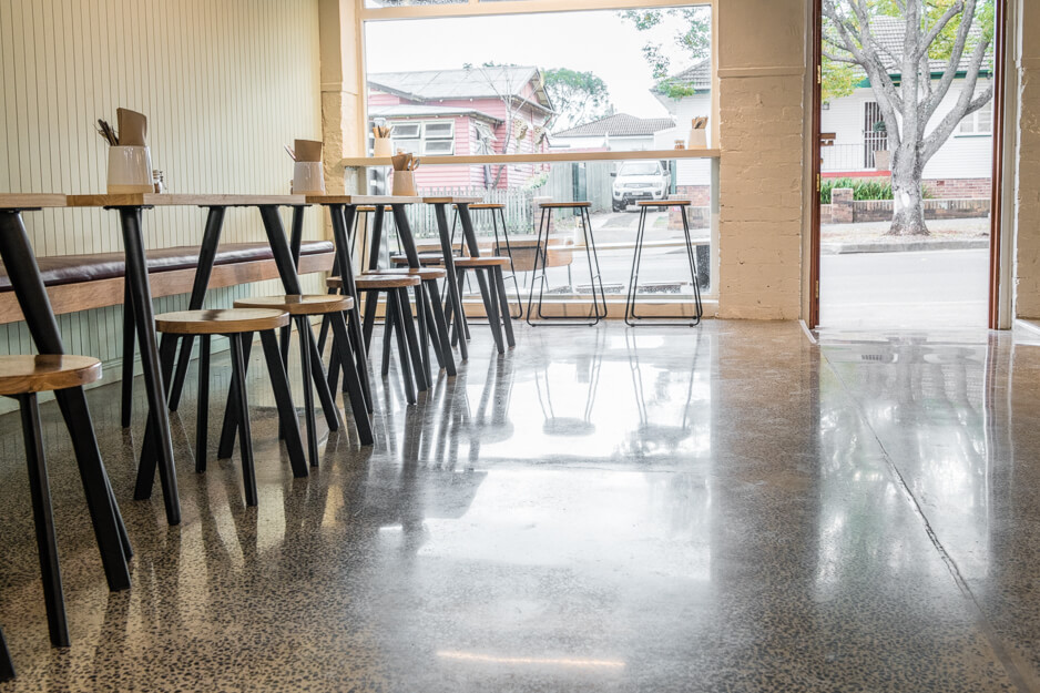 polished concrete floor in empty corner of cafe