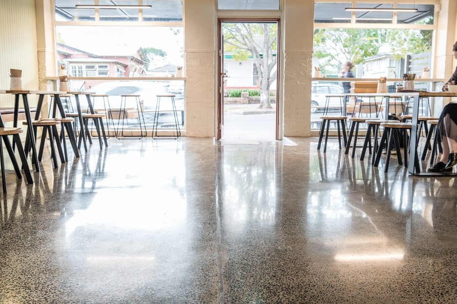 Photo of cafe from counter showing polished concrete floor