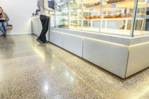 concrete floor near serving area of cafe