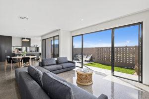 open plan living room with concrete floor