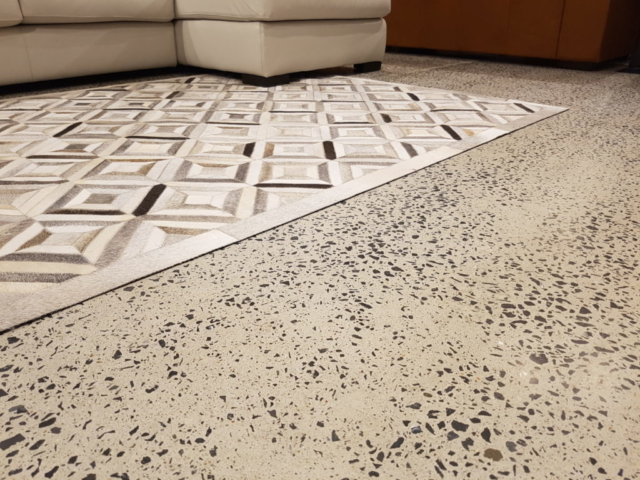 couch and rug on polished concrete floor