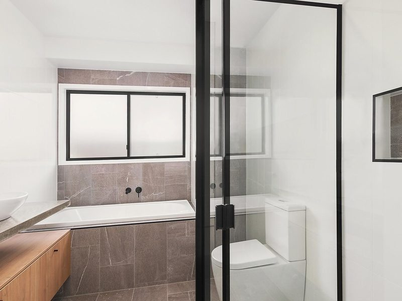 Concrete floor and feature wall in bathroom