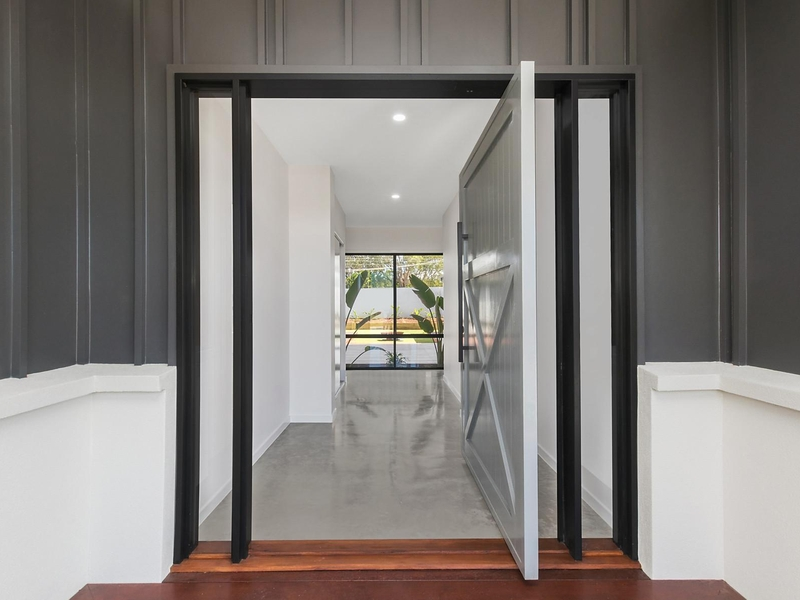 Modern doorway looking into room with polished concrete floor