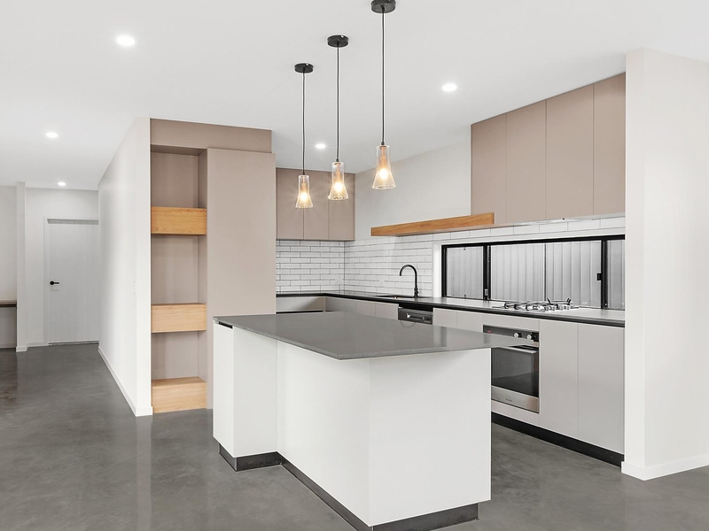 kitchen with concrete floor and bench