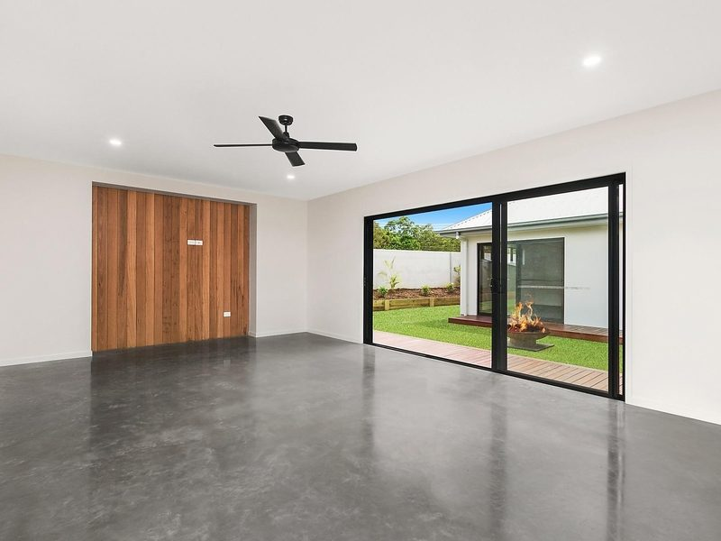 living room in display home with concrete floors