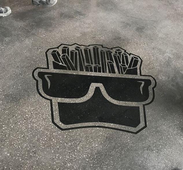 Boss Burger Co logo on concrete floor