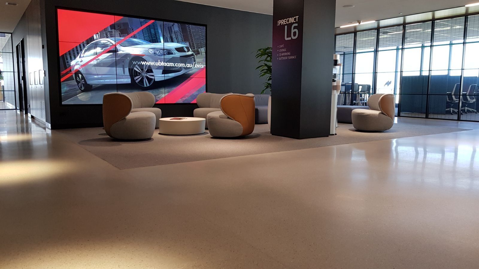 polished concrete floor in foyer of a commercial building