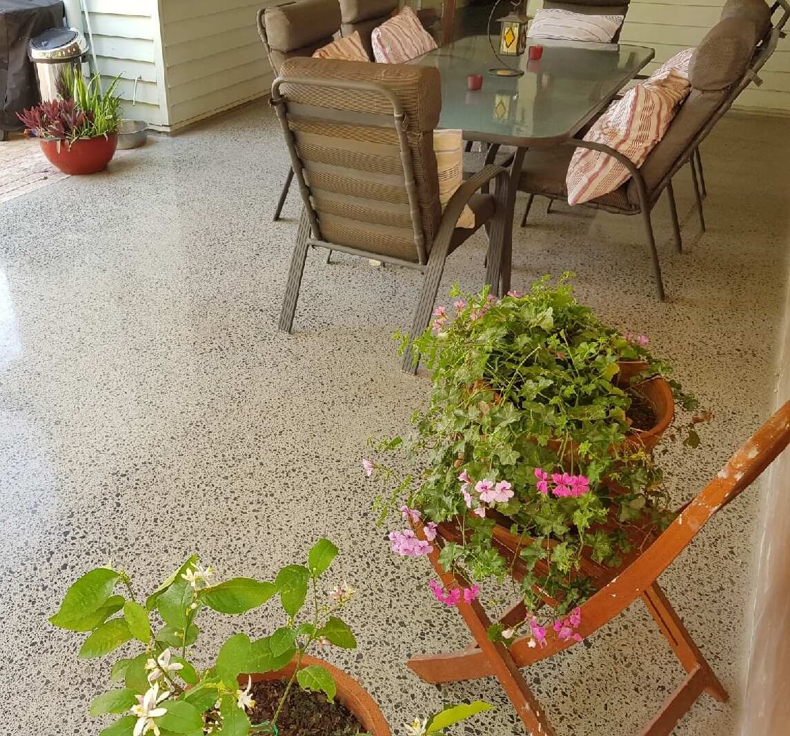 concrete floor in outdoor setting with three pot plants