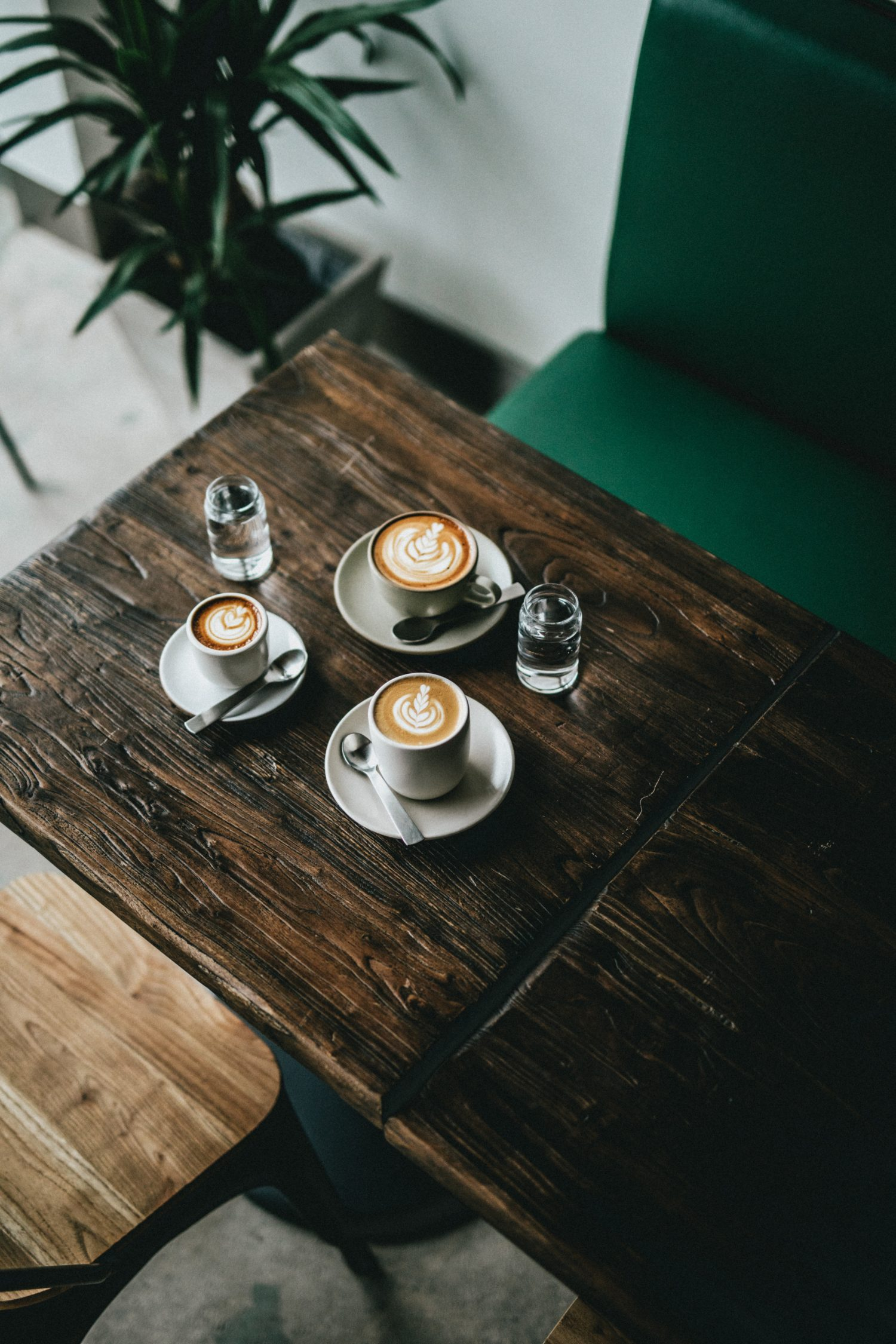 3 coffees on a table in a cafe