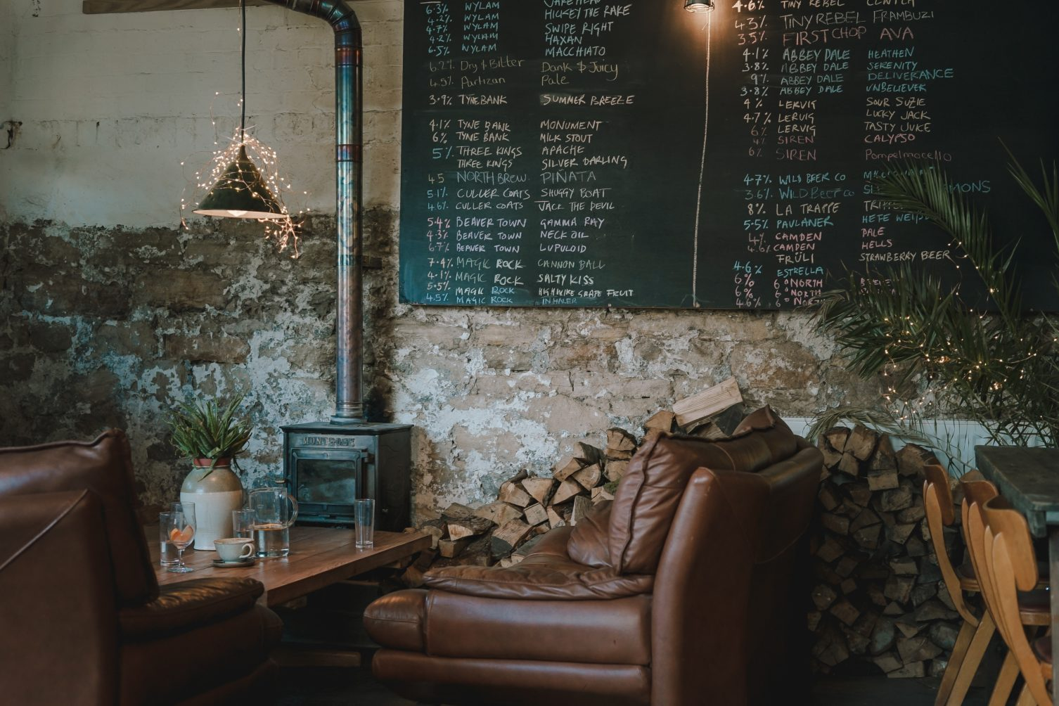 cafe with piles of wood against the wall