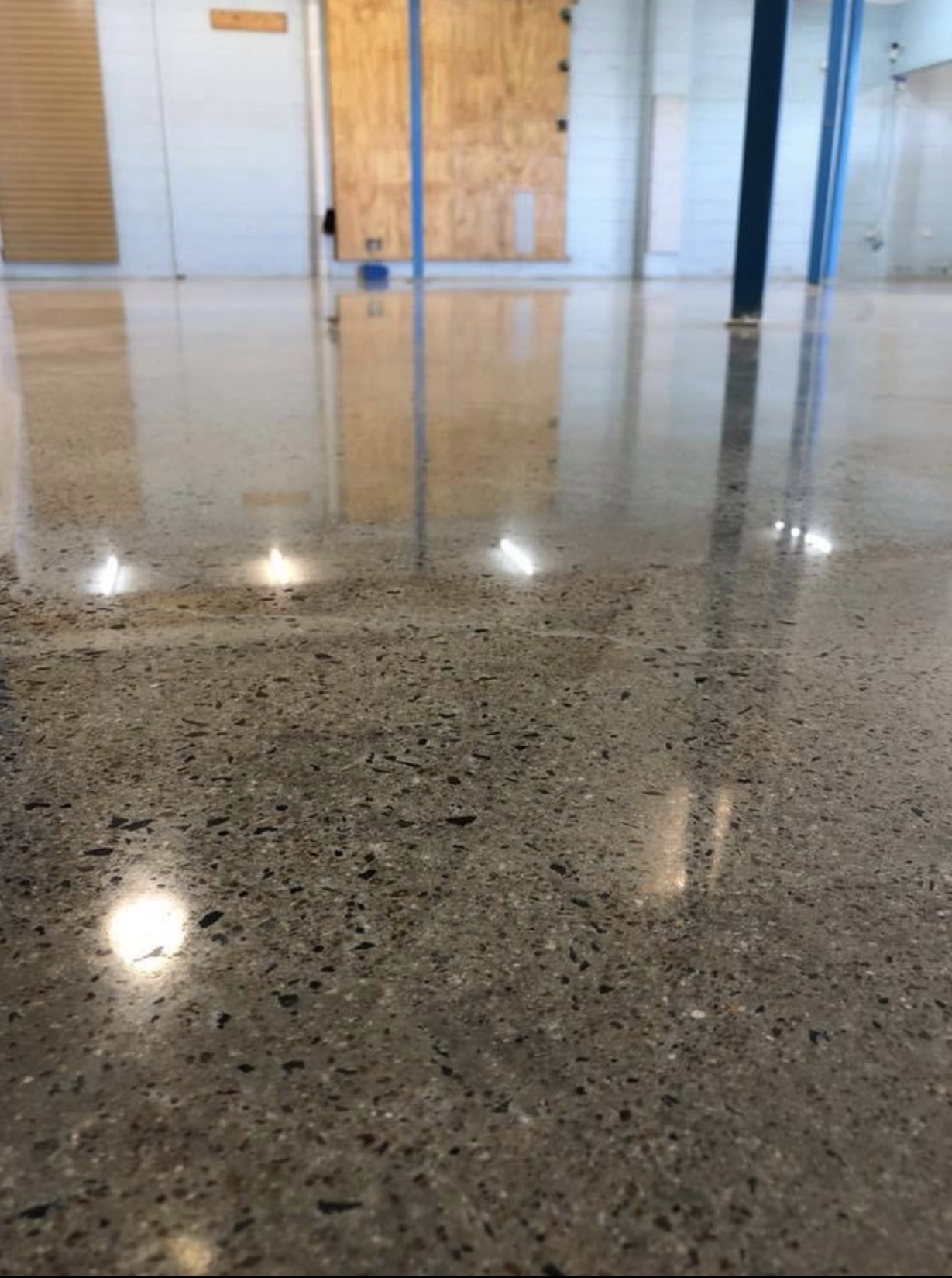 polished concrete floor at Think Water Shop